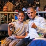 George with a young fan at an MMA show